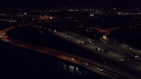 Motorway at night panning aerial establishing shot of Birmingham UK.