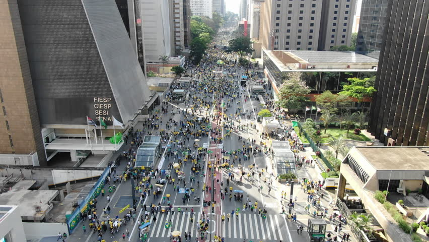SAO PAULO, BRAZIL - OCTOBER 22, 2018 - Large crowds of people marching in favor of presendital candidate Jair Bolsonaro for president. Drone aerial of Avenida Paulista