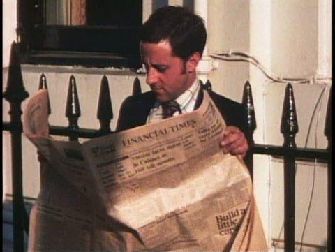 LONDON, ENGLAND, 1976, Man reads Financial Times, closeup of face
