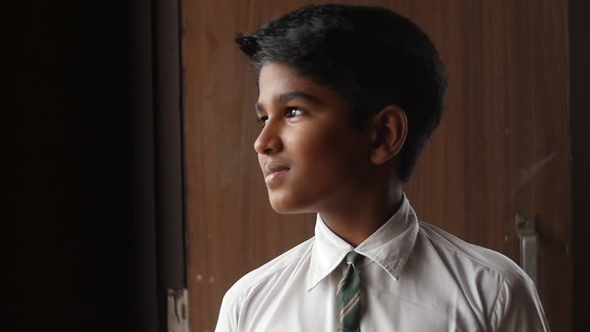 A young school going kid smiling and laughing in uniform | Shutterstock HD Video #1018516099