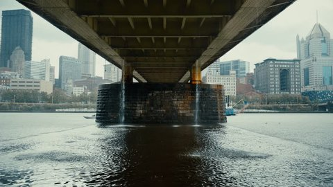 A river boat travels under the Andy Warhol Bridge on the Allegheny River during a Spring rain storm in Pittsburgh.