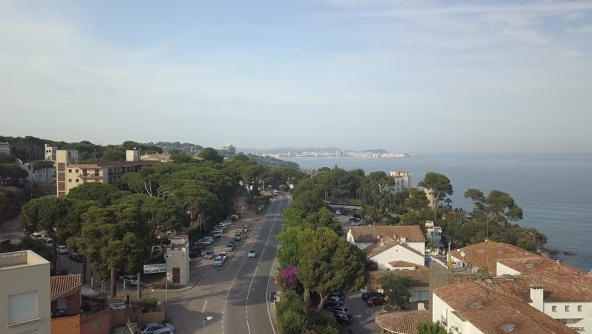 Seaside town aerial push forwards