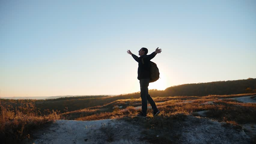 man silhouette striving for success hand to hand walking tourist hiking adventure climbers sunset climb the mountain . slow motion video. hiker sunlight on top lifestyle win victory the hill white #1018706809