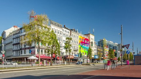 HAMBURG, GERMANY - OCTOBER 14, 2018: Day traffic at red-light district brothels and strip clubs at the Reeperbahn in Hamburg, Germany. Timelapse view.