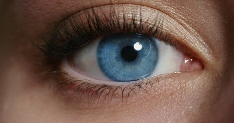 close up macro blue eye opening human iris natural beauty