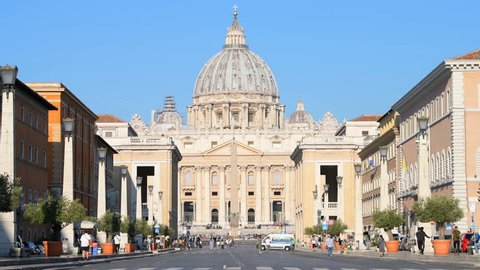 Rome, Italy - September 5, 2018: St Peter's Basilica, cathedral, square before papal general audience, people walking on Via Della Conciliazione street, road, crossing crosswalk in sunny morning
