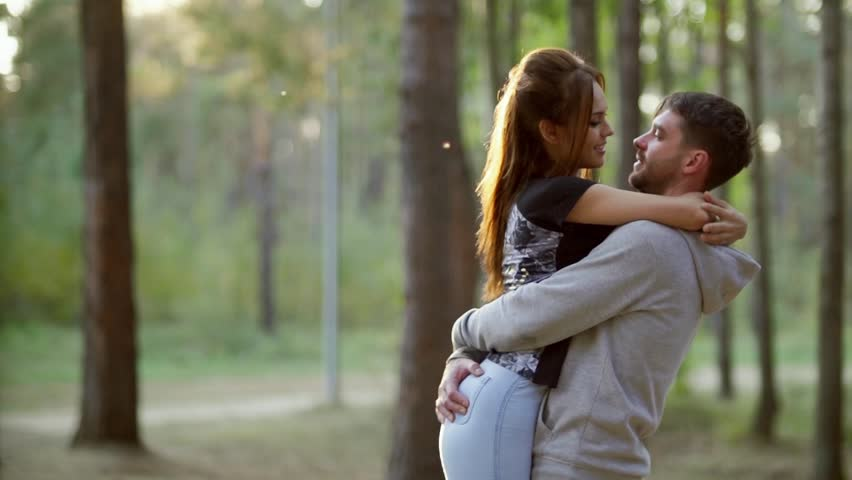 Couple in love cuddling in a park. Laughing joyful family. #1018917439
