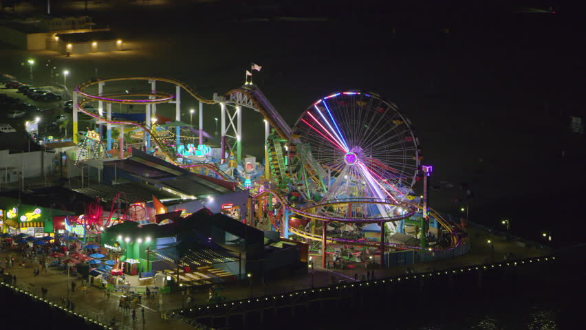 Aerial view of Santa Monica pier on a clear night in Los Angeles, California. Shot on 4K RED camera.   Shutterstock HD Video #1019022619