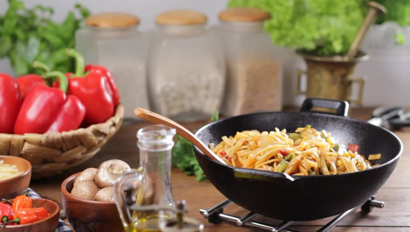 Indonesian pasta with chicken, pieces of bamboo and mushrooms. Seasoning, mixing, sprinkling and translating the dish. | Shutterstock HD Video #1019075749