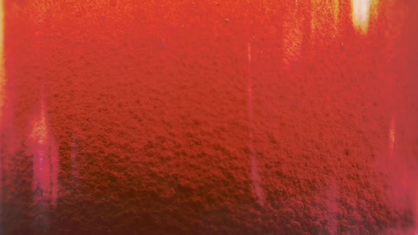 Red liquid with air bubbles #1019210539
