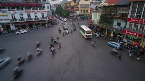 Hanoi, Vietnam-09/2018: Timelapse or time lapse of crowded traffic in city. Traffic in downtown Hanoi capital with lots of motorcycles, motorbike, bus, car, and people walking crowded on the street