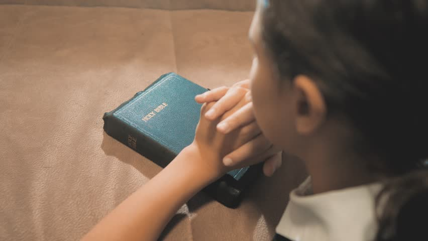 Little girl teenager praying in the night. Little girl hand praying. little girl holy bible prays with bible in her hands. the catholicism sacred holy bible. children and religion upbringing faith | Shutterstock HD Video #1019230639