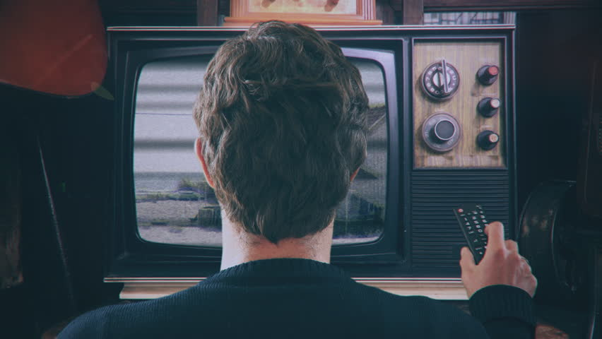 Channel Surfing TV Remote Control Vintage Television. Man with TV remote control changing channels in a vintage style technology. Old Television | Shutterstock HD Video #1019305039