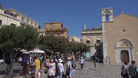 TAORMINA, SICILY/ITALY - SEPTEMBER 26, 2018: Unidentified tourists visit Piazza IX April square, Sicily. Taormina in metropolitan Messina has been a tourist destination since the 19th century.