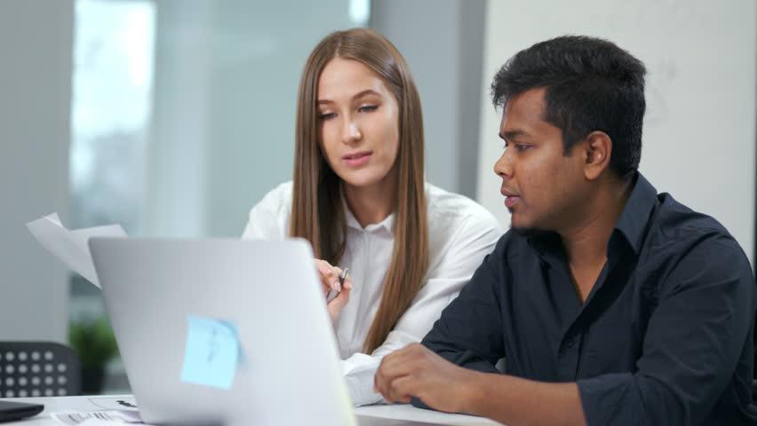 European businesswoman and African businessman discussing working at modern office | Shutterstock HD Video #1019412769