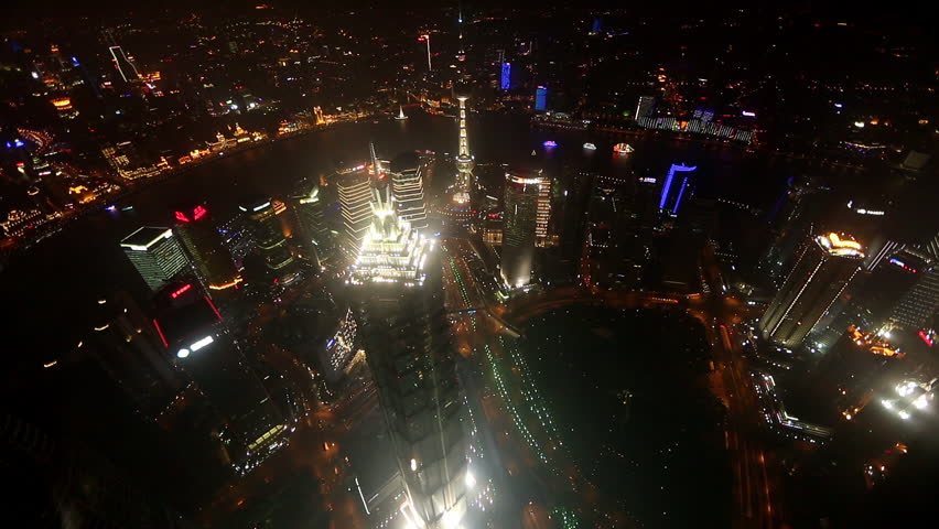 Looking Down From A Tall Building At Night