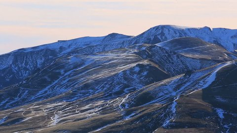 Panorama of a volcanic relief featuring Puy de Sancy in Central Massif, France, in a late autumn cold day.