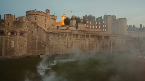 LONDON, circa 2018 - The Tower of London enshrouded in smoke during Beyond the Deepening Shadow - The Tower Remembers tribute to fallen WW1 soldiers