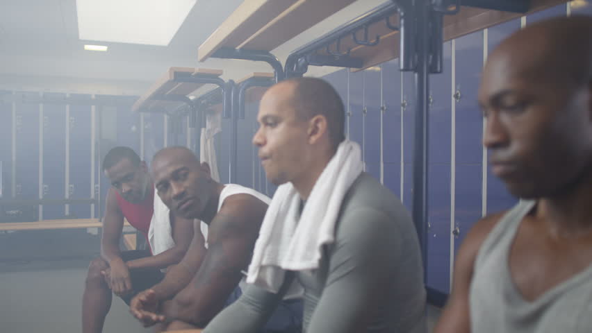 4K Disappointed sports players in team locker room, reflecting on a losing game. | Shutterstock HD Video #10195499