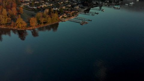 A panning aerial shot of waterfront home in Deep Cove, North Vancouver, BC, at sunrise.