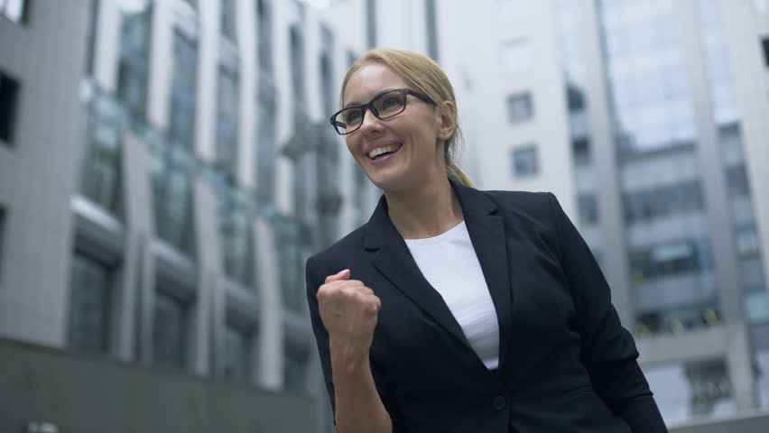 Woman showing success gesture, extremely happy about breakthrough in startup | Shutterstock HD Video #1019577709