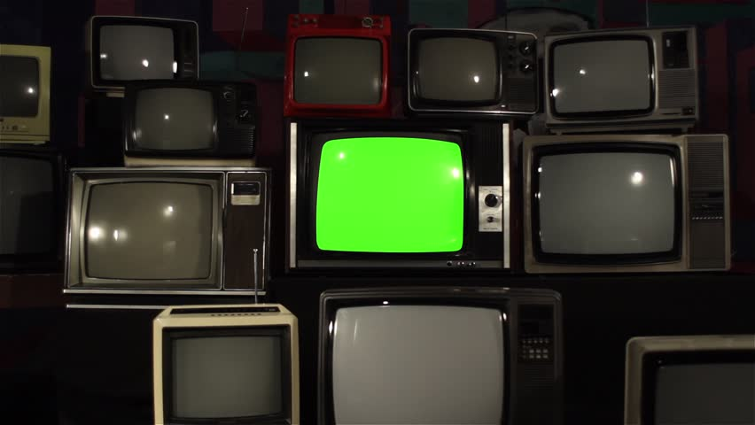 """80s TV Green Screen over 80s TVs. Dolly In Fast. You can Replace Green Screen with the Footage or Picture you Want with """"Keying"""" effect in After Effects (check out tutorials on YouTube).  