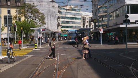 ZURICH, SWITZERLAND - MAY 22 2018: city sunny day tram road trip pov backside window panorama 4k circa may 22 2018 zurich, switzerland.