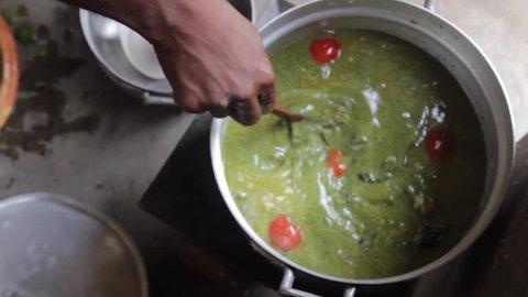 Coking soup in  rural Ghana