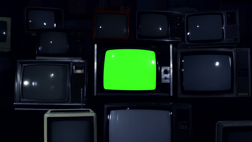 "80s TV Green Screen with Many 80s TVs. Dolly In Fast. Night Tone. Ready to Replace Green Screen With any Footage or Picture you Want. You Can Do it With ""Keying"" (Chroma Key) Effect in After Effect. 
