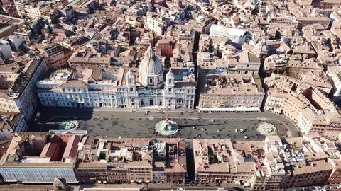 Aerial drone video of iconic landmark Piazza Navona (Square) featuring Fountain of the Four Rivers with an Egyptian obelisk and Sant Agnese Church in the heart of Rome, Italy