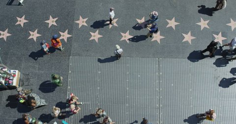 Hollywood, California, United States - April, 2017: High angle of tourists walking on the Walk of Fame