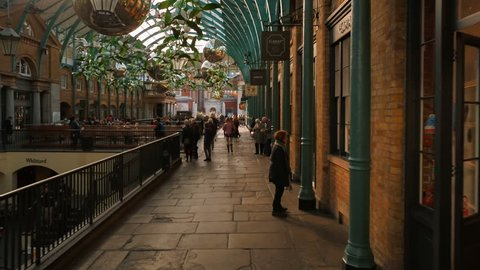 LONDON, circa 2018 - POV walk along the interior of the famous Covent Garden arcade in London, England UK, a former fruit and vegetable market