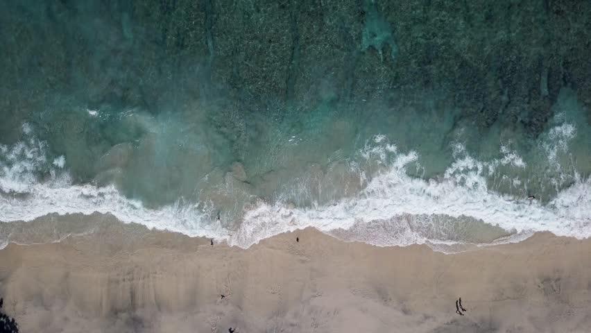 Aerial top view waves break on sand beach | Shutterstock HD Video #1019846749