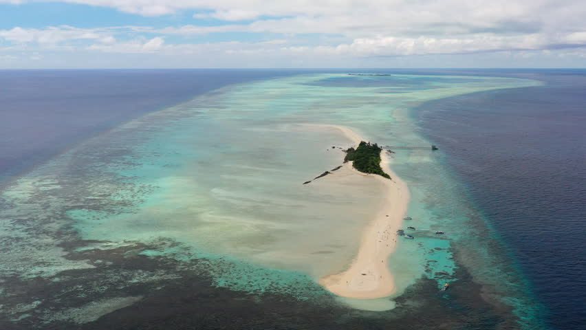 Aerial panoramic view of sandy islet Timba Timba, turquoise crystal clear waters of Celebes Sea, white sand beaches and coral reefs  - landscape panorama of Borneo island, Malaysia, Pacific Ocean | Shutterstock HD Video #1019847979
