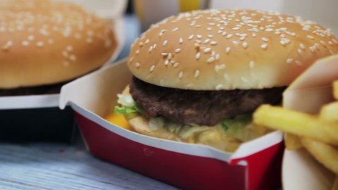 Moscow, Russia - November 18, 2018: big Mac, French fries, Coca Cola and other food at McDonald's fast food restaurant in Moscow. Rotation video