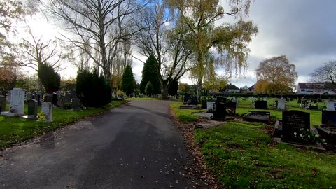 Coventry, West Midlands, UK - November 13, 2018: Hyperlapse in London Road cemetery in Coventry towards World War 2 memorial and mass grave of those who were killed in the blitz