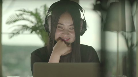 Young Asian Woman Using Computer in Apartment at Home
