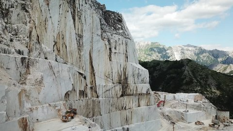 Aerial: Flying above world famous marble quarry near the city of Carrara, Tuscany, Italy