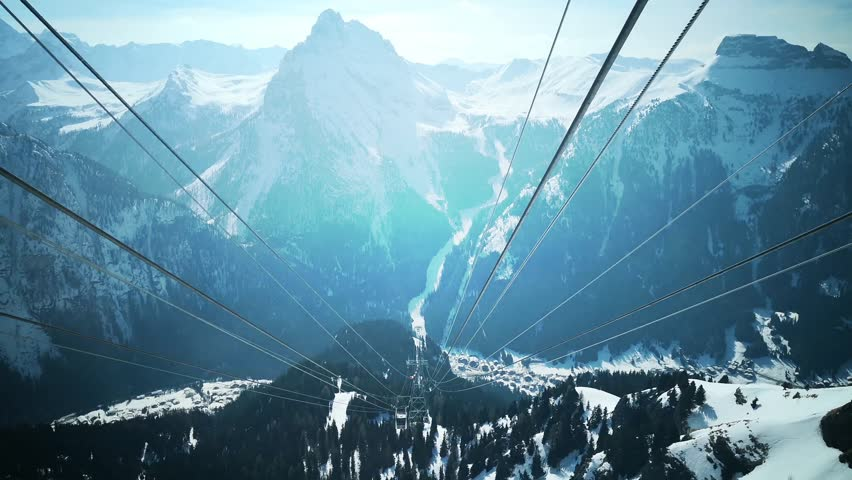 Footage of some snowy mountains viewed from a cable car. | Shutterstock HD Video #1020001099