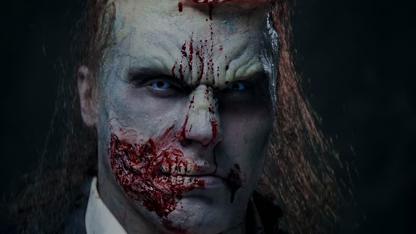 Scary zombie prostheric makeup on male model   Shutterstock HD Video #1020025759
