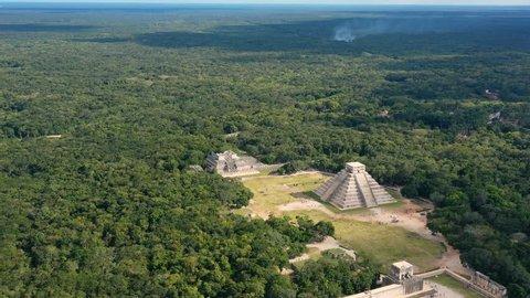 Aerial view of ancient Mayan city of Chichen Itza, famous mesoamerican pyramid El Castillo (Temple of Kukulkan) - landscape panorama of Yucatan Peninsula from above, Mexico, North America, 4k UHD