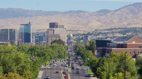 Classic panoramic view of Boise skyline with famous Idaho State Capitol and mountain range in the background on a beautiful sunny day with blue sky, Idaho, USA