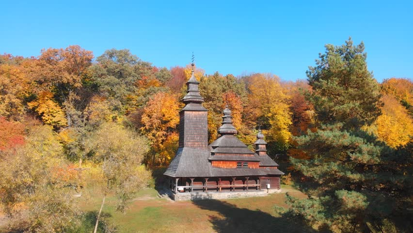 Traditional. all wood architecture of a rural Orthodox Christian church. surrounded by autumn leaves. as seen in Pirogovo Village. Ukraine. Ultra HD 4k stock footage   Shutterstock HD Video #1020178909