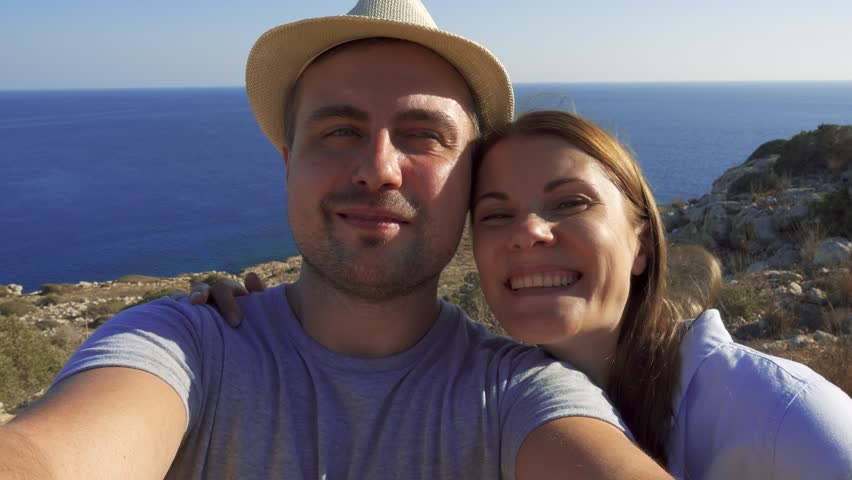 Image of: Funny Pranks Pov View Of Funny Loving Young Couple Doing Selfie At Edge Of Cliff Girlfriend Kissing Boyfriend On Cheek Breathtaking View Of Blue Mediterranean Sea On Youtube Pov View Of Funny Loving Stock Footage Video 100 Royaltyfree