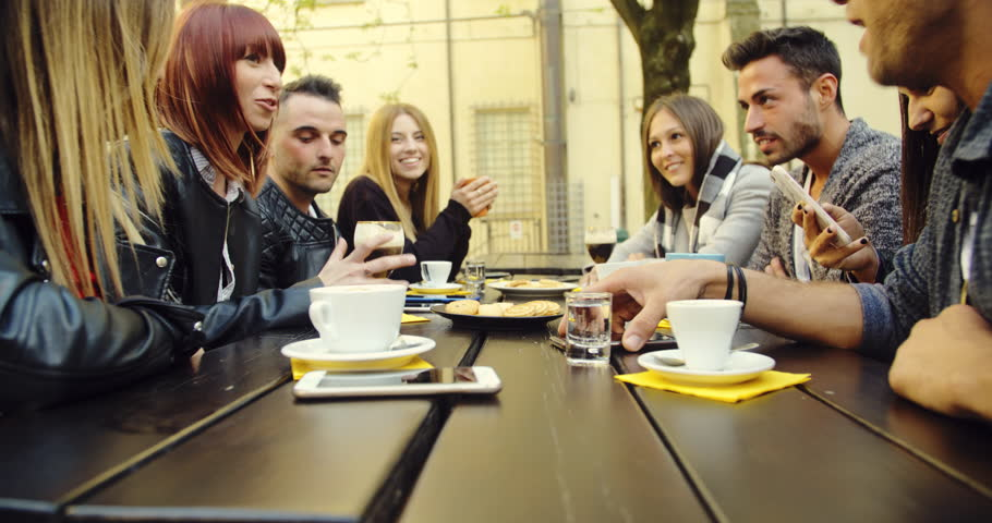 Large group of friends in an outdoor cafeteria | Shutterstock HD Video #1020281689