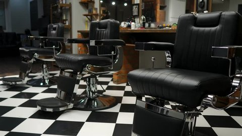 Authentic haircut for men. Barbershop in retro style. Steadicam shot