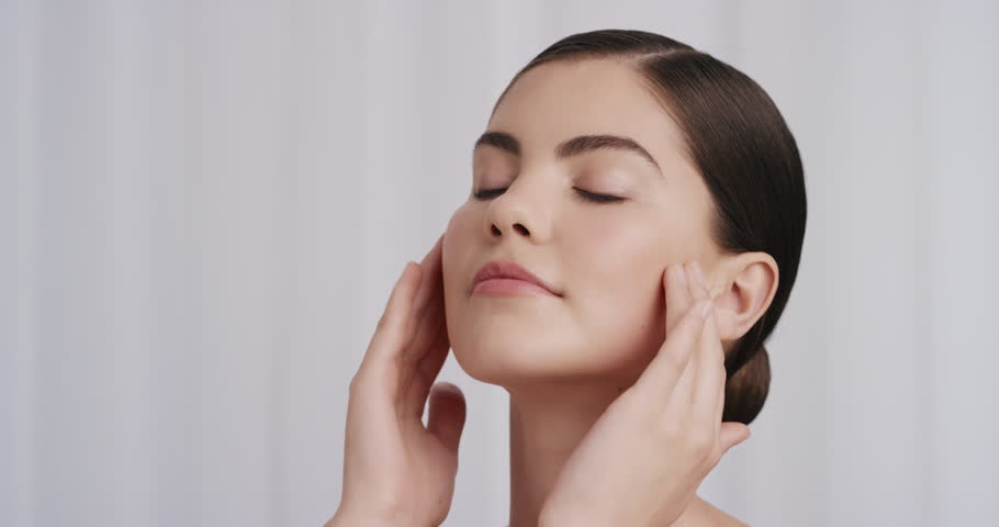 Portrait healthy young woman gently touching skin with hands caressing smooth soft complexion beautiful caucasian female enjoying luxury skincare sensual relaxation 4k footage shot on Red Epic Dragon | Shutterstock HD Video #1020306049