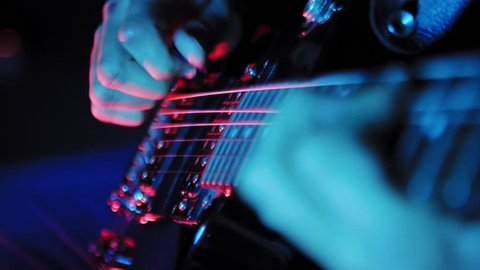 Close up on hands playing on electric guitar 4K