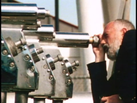 SAN FRANCISCO, CALIFORNIA, 1979, Close up of man peering through a telescope