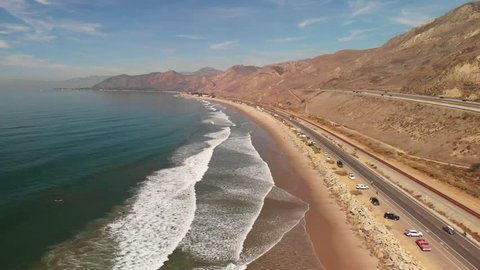 Aerial shot of of the Pacific Coast Highway along California beach